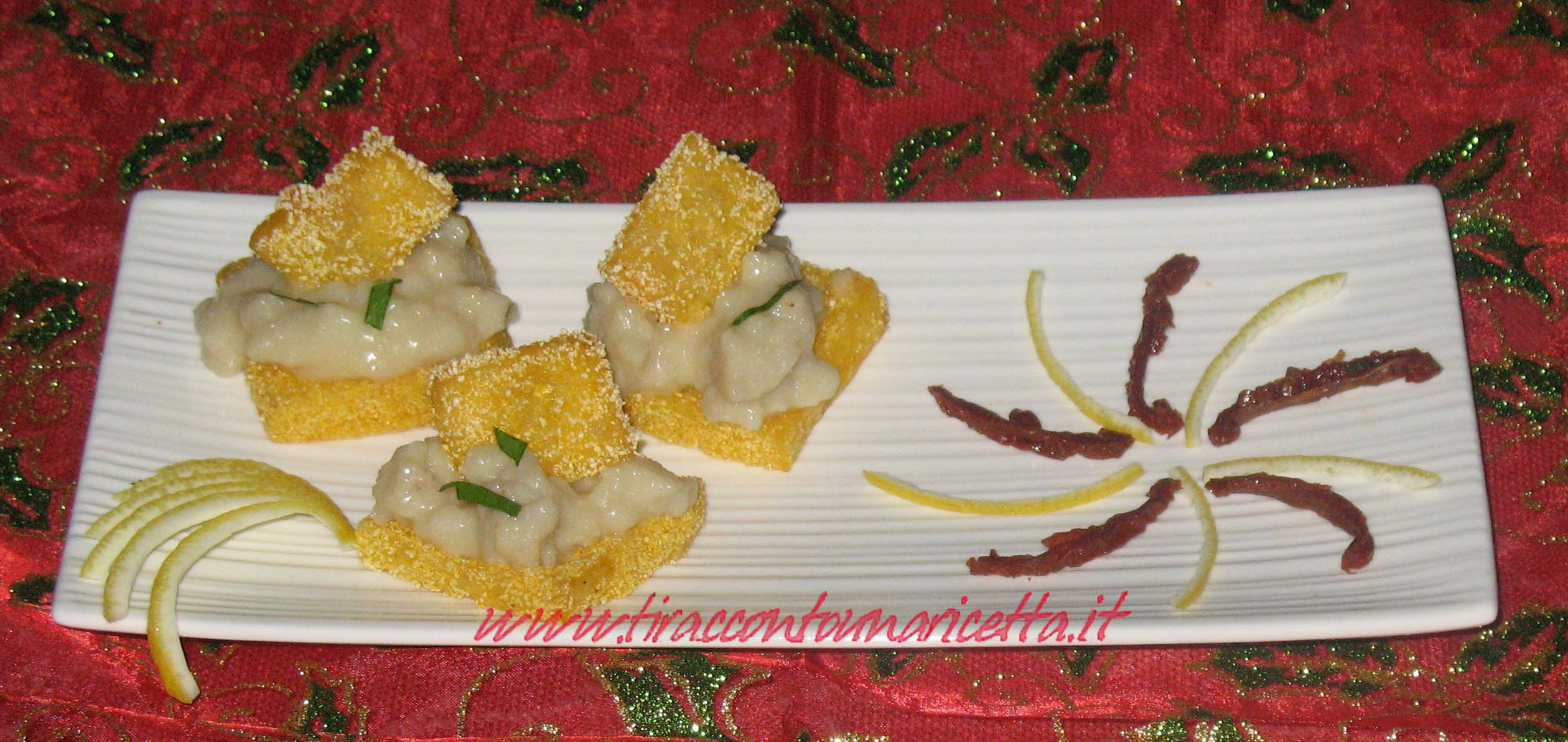 Small sheets of polenta with chopped salted cod