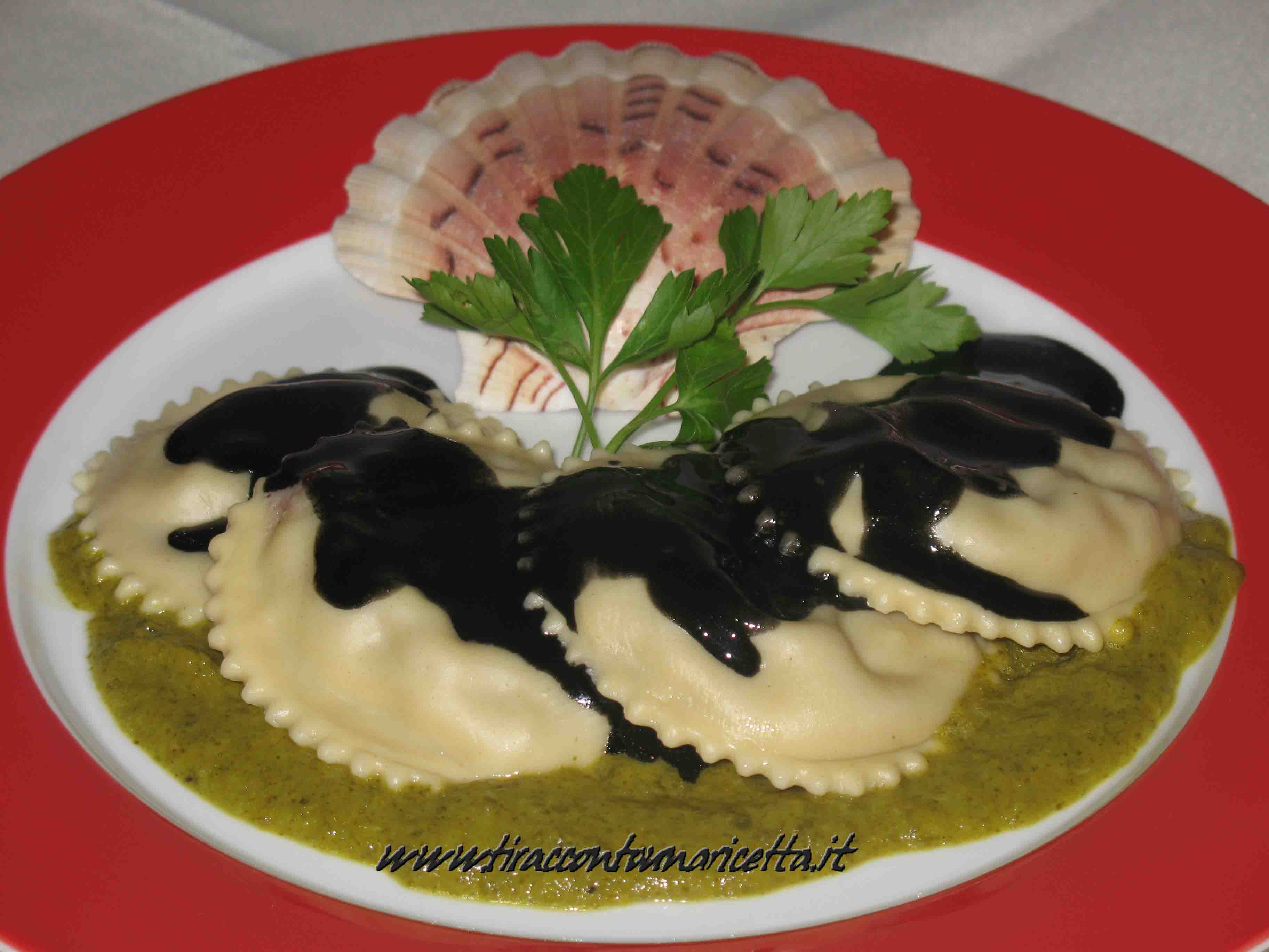 Ravioli with seafood and sepia on cream of lettuce