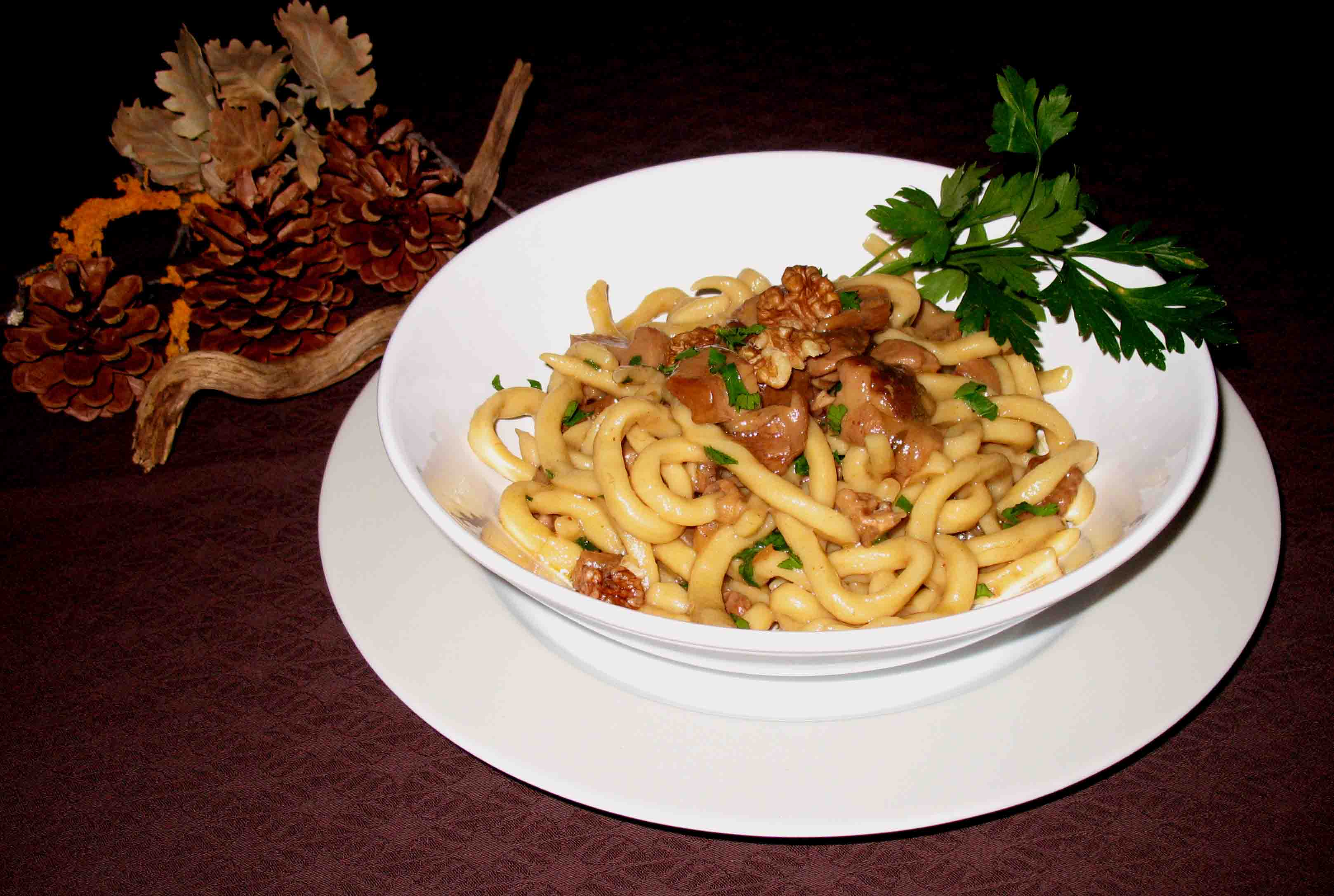 Strozzapreti with porcini mushrooms and nuts