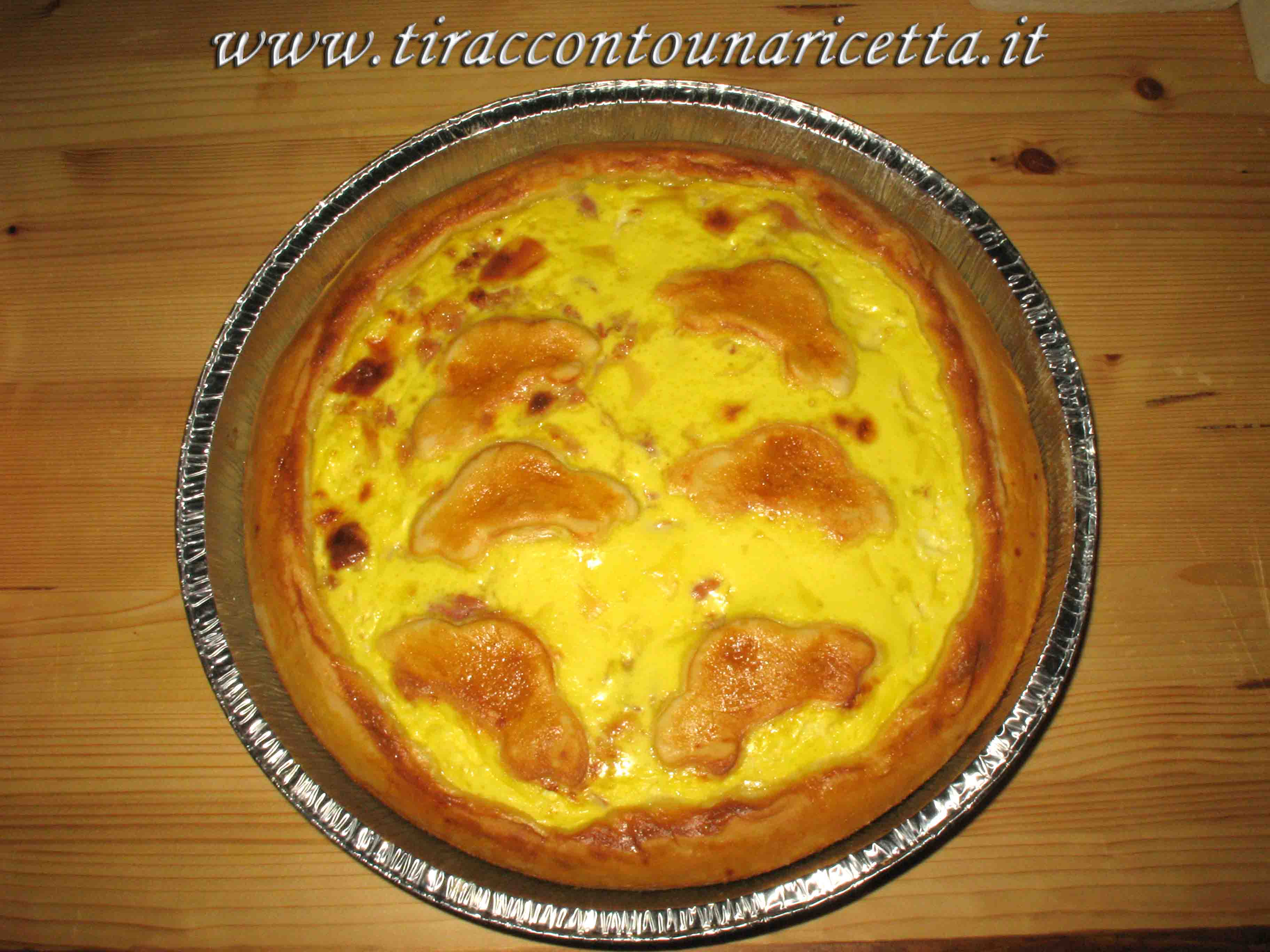Rustic pie with bacon and Swiss cheese (Emmenthal)