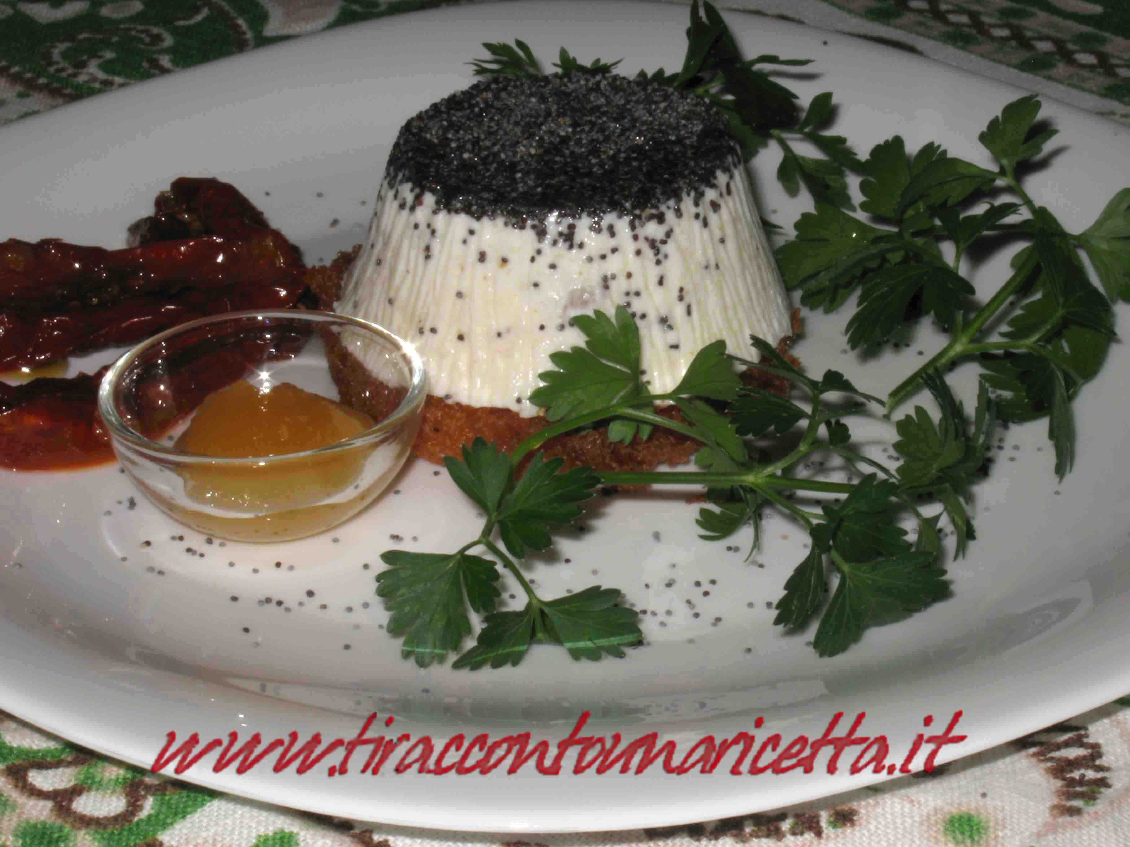 Semifreddo salty with cheese with sun-dried tomatoes, poppy seeds and millefiori honey