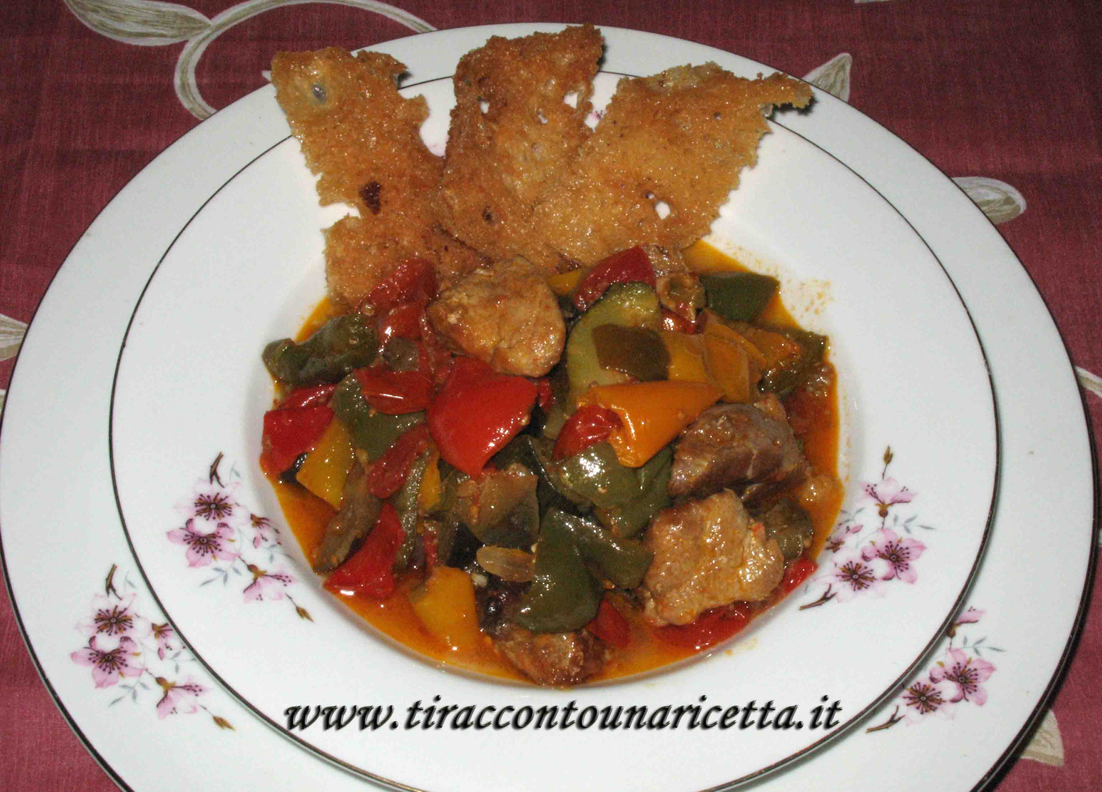 Pork stew with peppers, zucchini and eggplant