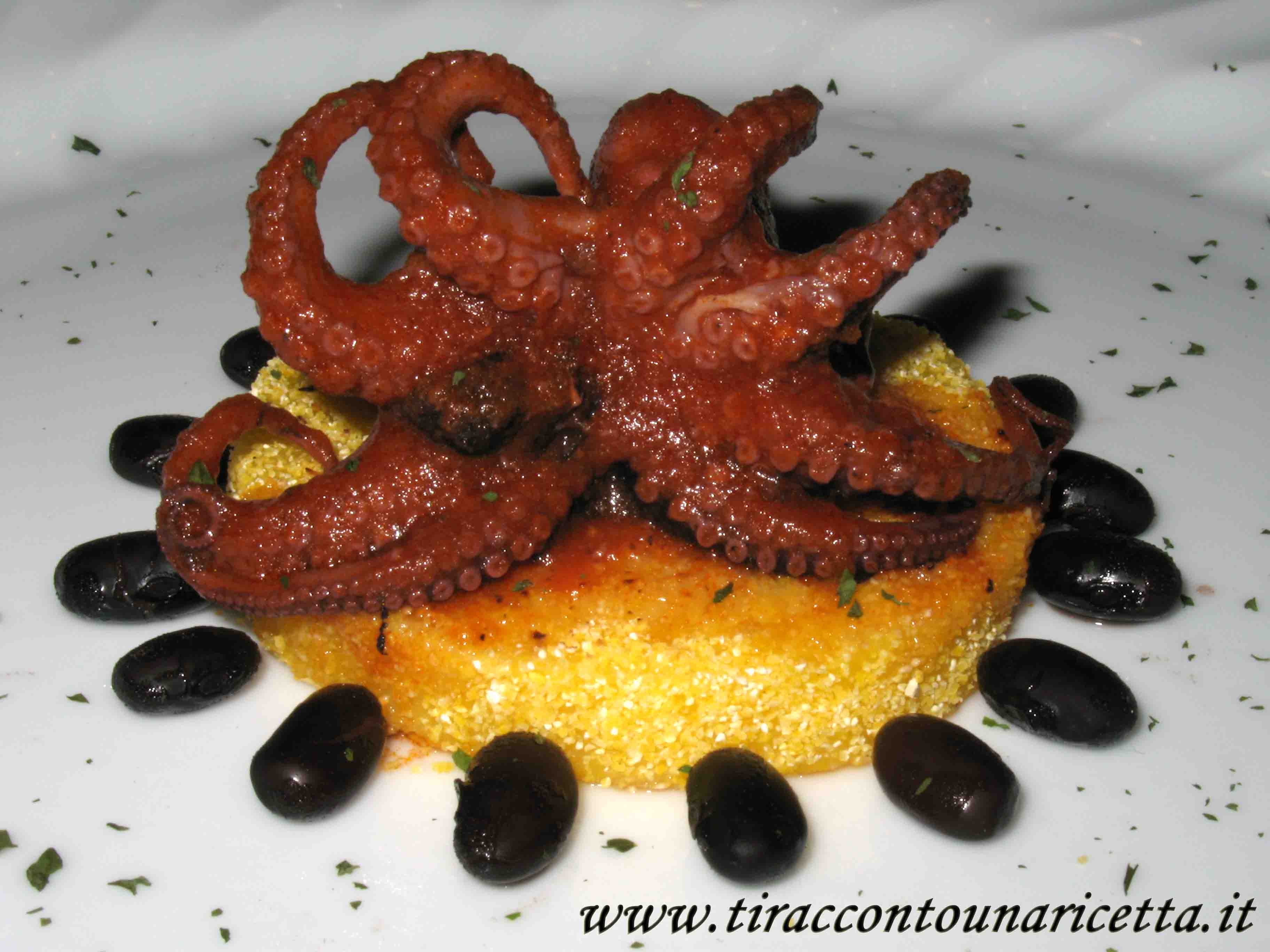 Medallions of  polenta with baby octopus and black beans